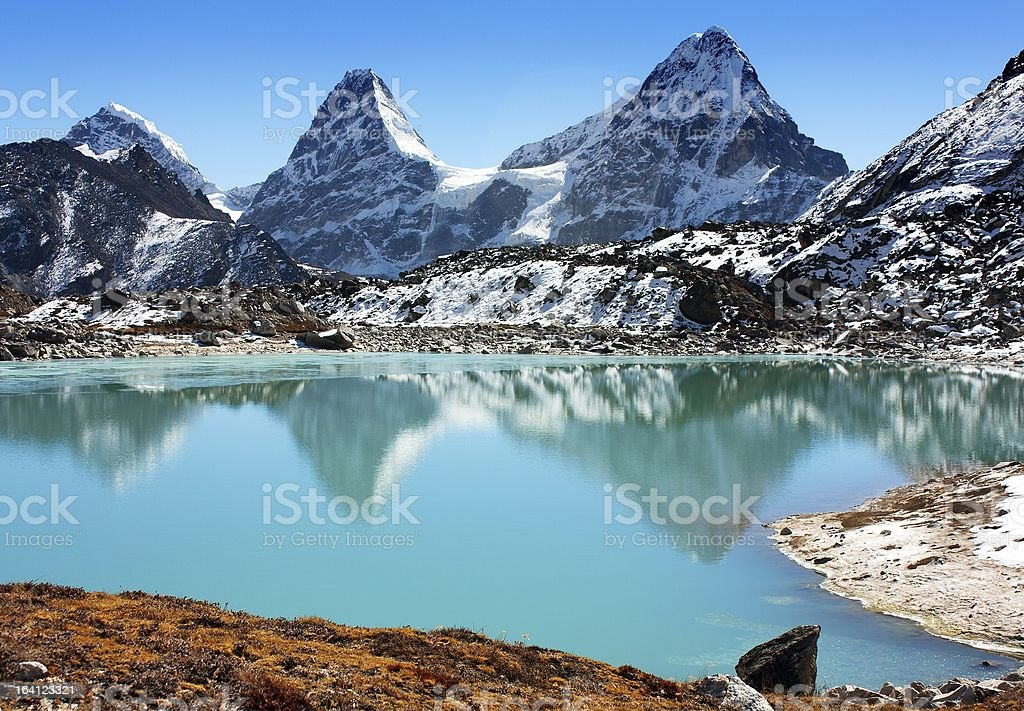 A mountain range overlooking a vast and open lake stock photo