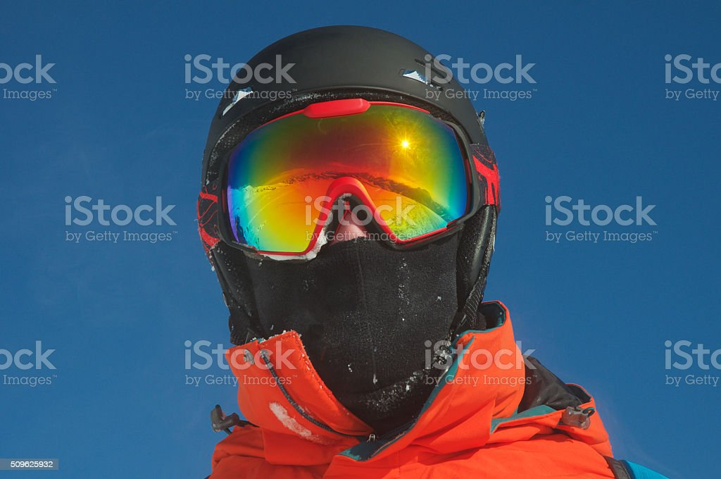 Mountain range reflected in the ski mask stock photo