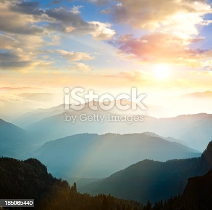 istock Mountain range with sun setting in background 185065440