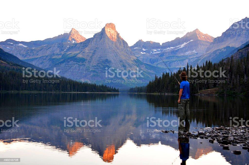 Mountain Reflection and Fisherman stock photo