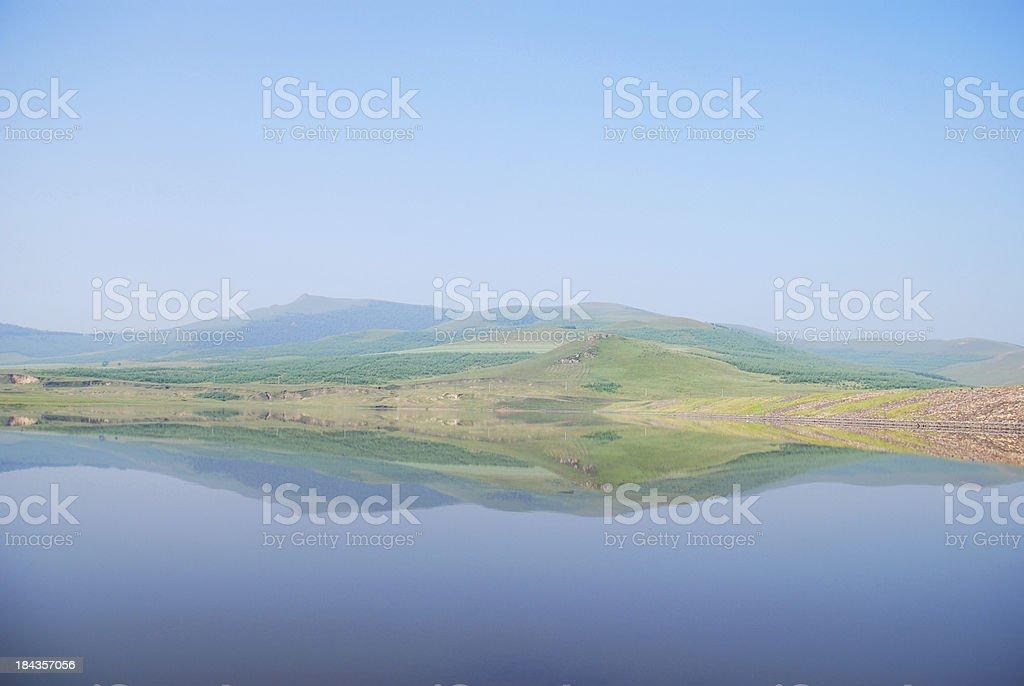 Mountain reflection in lake royalty-free stock photo