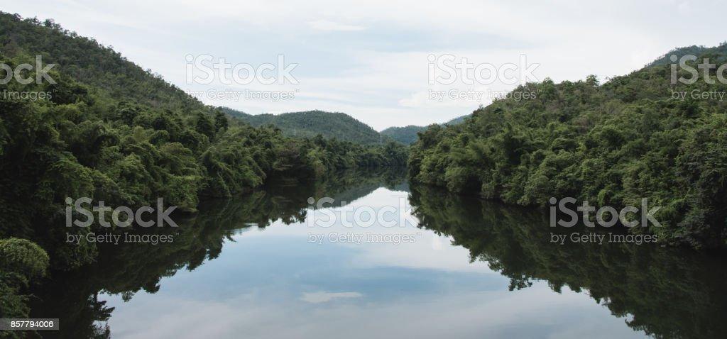 Mountain Reflection on the Khwae Yai River, Thailand stock photo