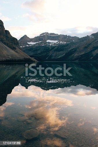 820775686 istock photo Mountain reflection 1210419189
