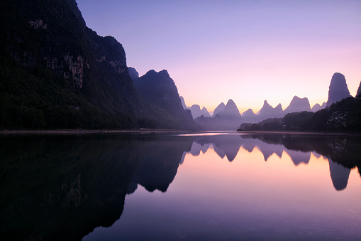 Mountain reflections at dawn in autumn, Guilin, China