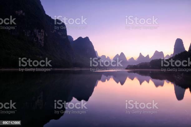 Photo of Mountain reflections at dawn, Guilin, China