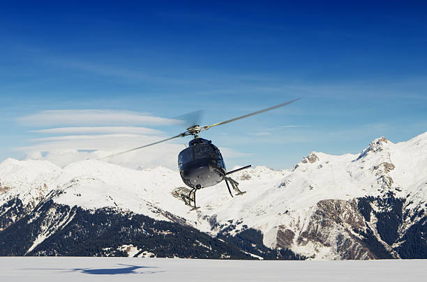 Mountain rescue helicopter in flight stock photo