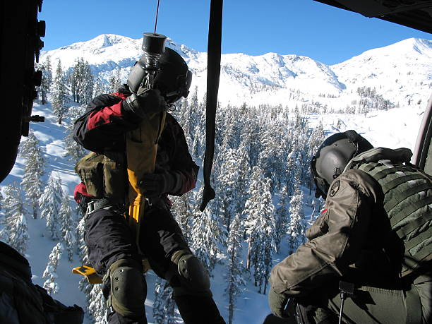 mountain rescue - cable winch stock photos and pictures