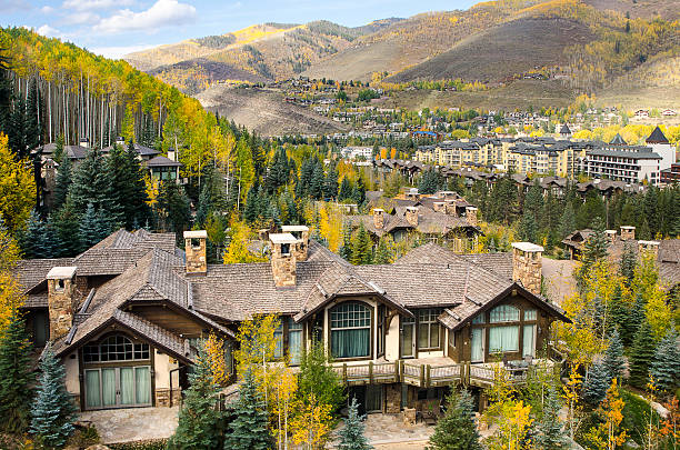 Mountain Resort Village of Vail, Colorado in the Rocky Mountains The famous ski village of Vail, Colorado. The village was established and built as the base village to Vail Ski Resort, with which it was originally conceived and is the third largest ski mountain in North America. Vail attracts wealthy visitors, many of whom, who build and purchase vacation homes and condominiums near the ski slopes. Taken in Vail, Colorado in early October. vail colorado stock pictures, royalty-free photos & images