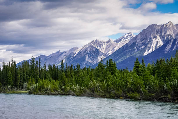 Mountain Ridge and Bow River in Canmore, Alberta, Canada stock photo