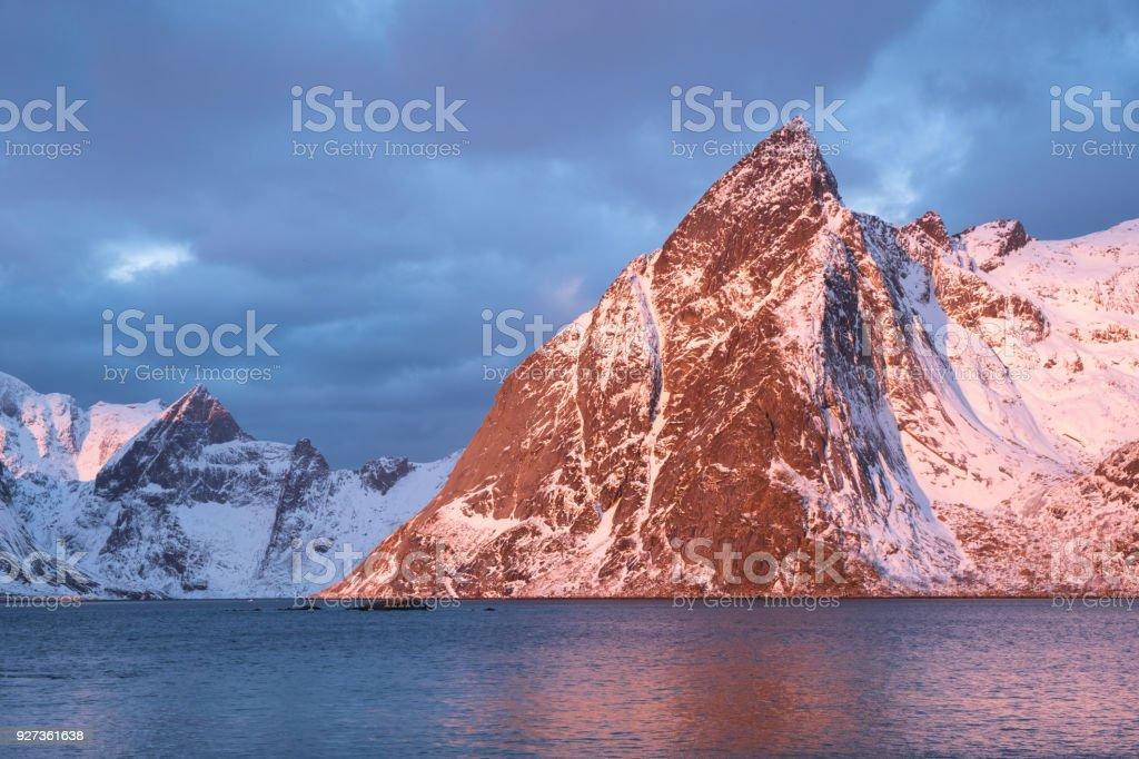 Mountain ridge and reflection in the lake. Natural landscape in the Norway Mountain ridge and reflection in the lake. Natural landscape in the Norway Adventure Stock Photo