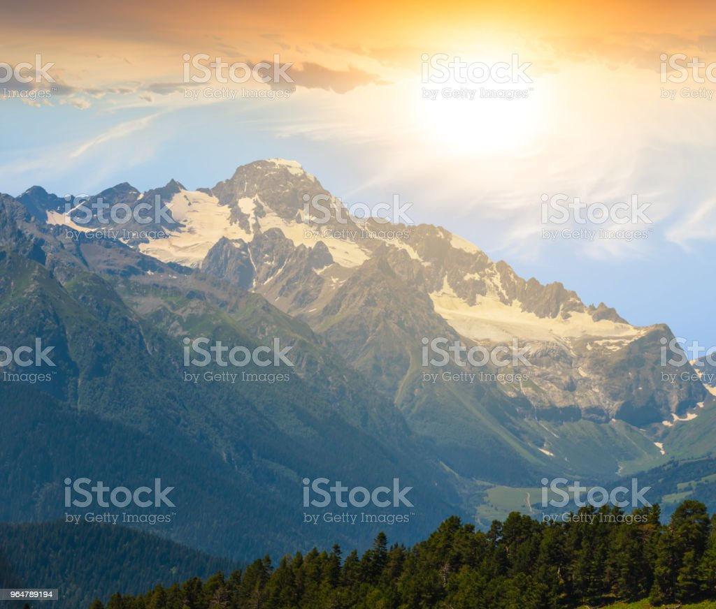 mountain ridge in a snow at the sunset royalty-free stock photo