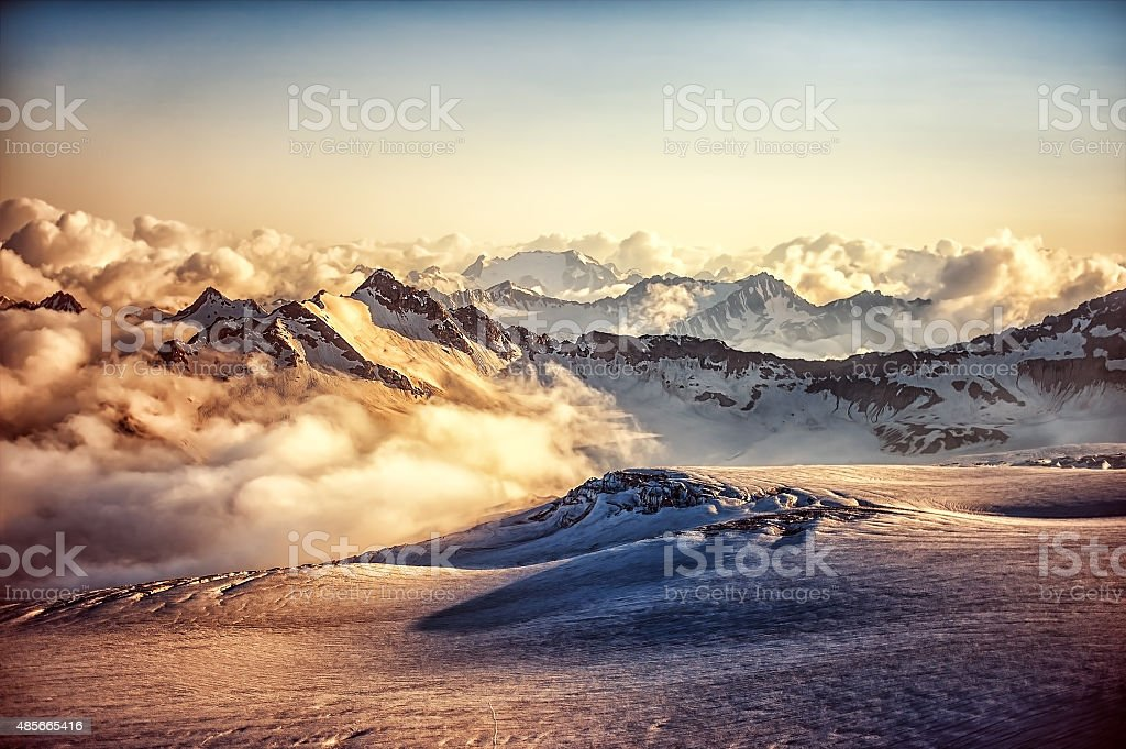 mountain ridge of Western Caucasus at sunset or sunrise stock photo