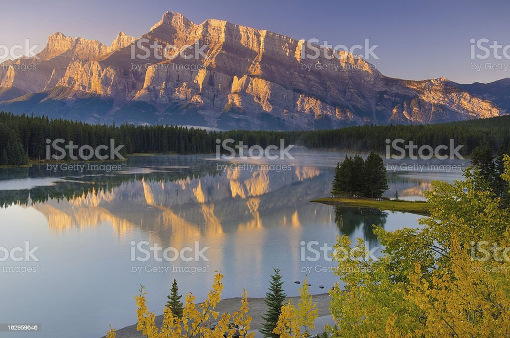 Mountain ridges golden in sunrise light stock photo