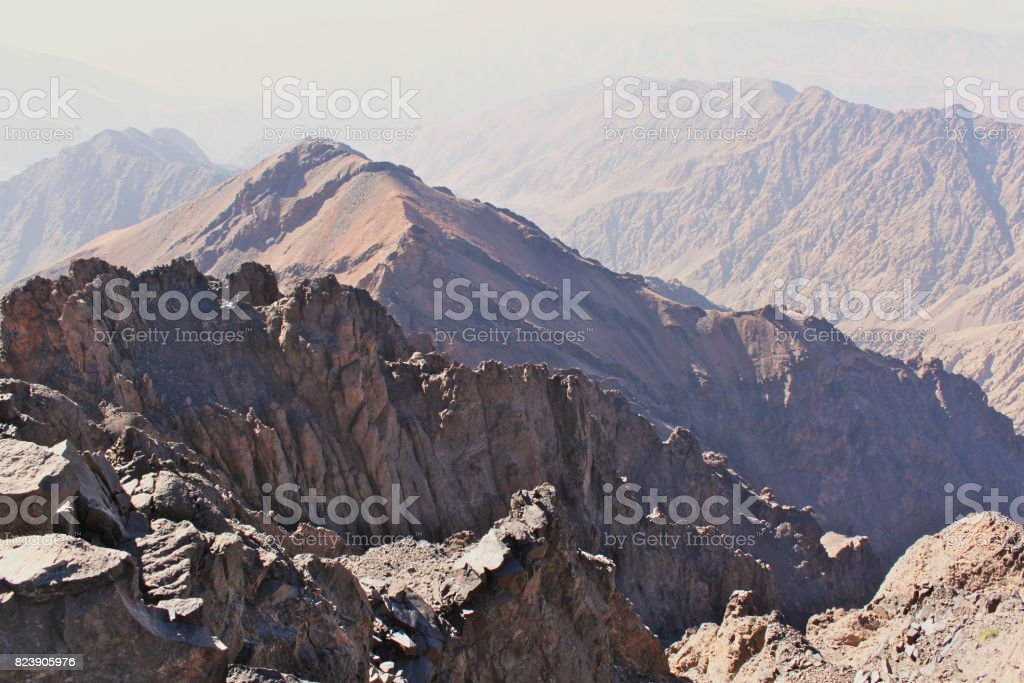 Mountain ridges in Morocco. Trekking on Toubkal - the highest peak. stock photo