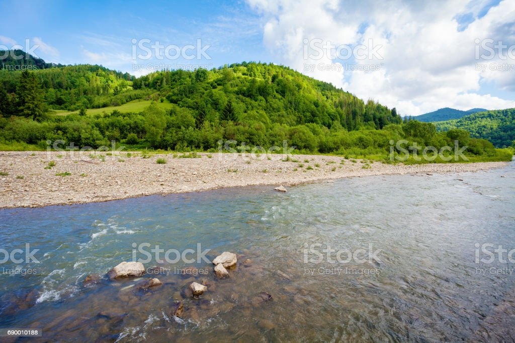 Mountain river and green hill stock photo