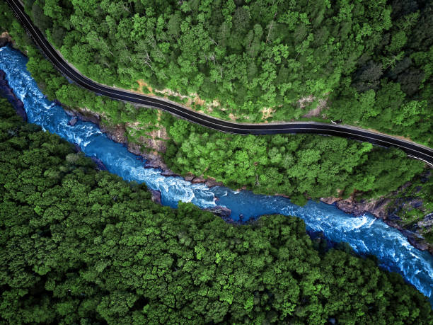 mountain river and road aerial view - river stock photos and pictures