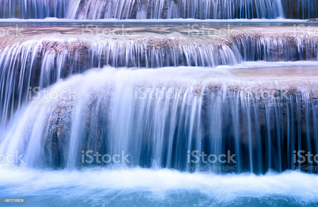 Mountain river background with small waterfalls royalty-free stock photo