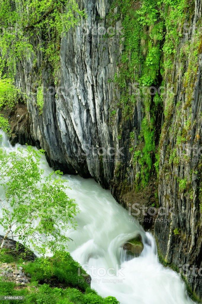 Mountain river in deep canyon, outdoor springtime theme stock photo