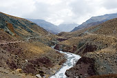istock mountain river in Tibet. The waters of the Himalayas. 1292886419