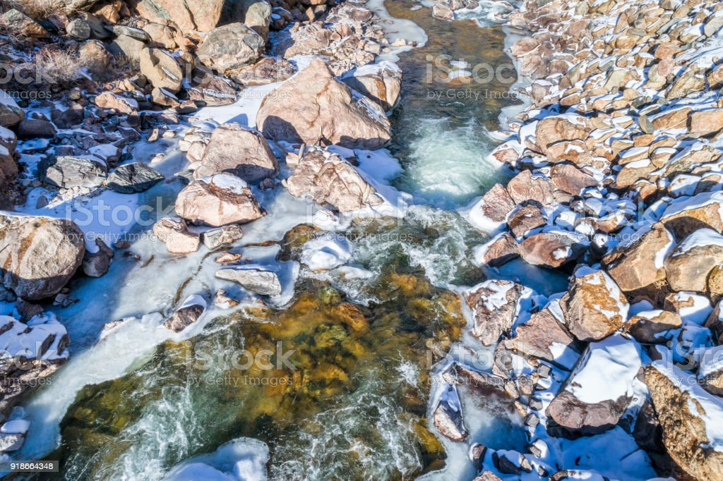 mountain river in winter scenery from above stock photo