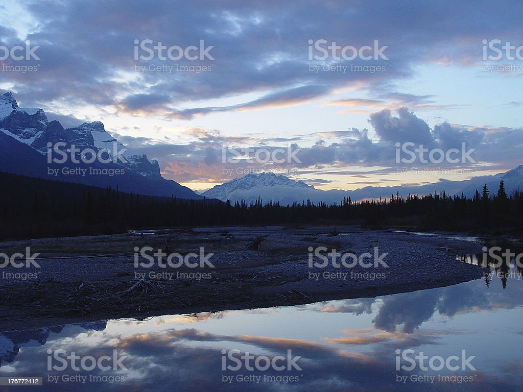 mountain river reflections at sunset stock photo