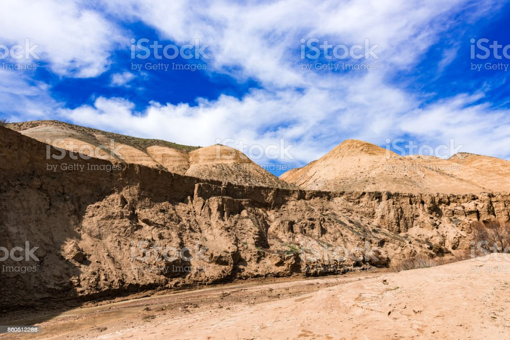 Mountain river with yellow water stock photo