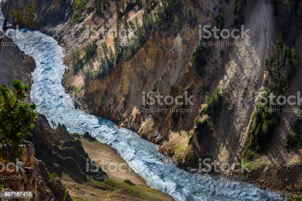 Photo of Mountain river. Yellowstone mountain waterfall river landscape, closeup.