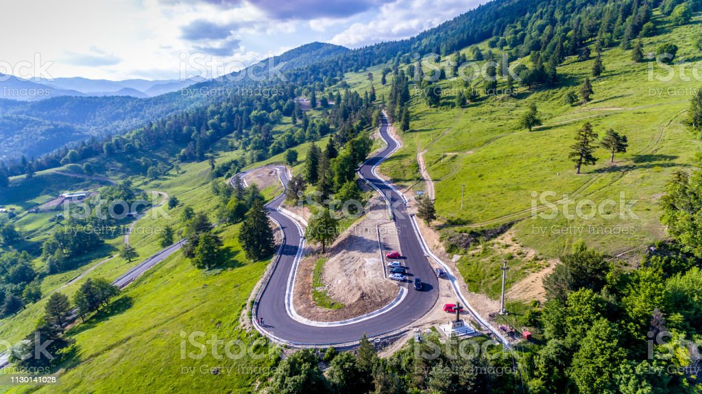 Aerial footage. Tracking car from above. Flying over the road.