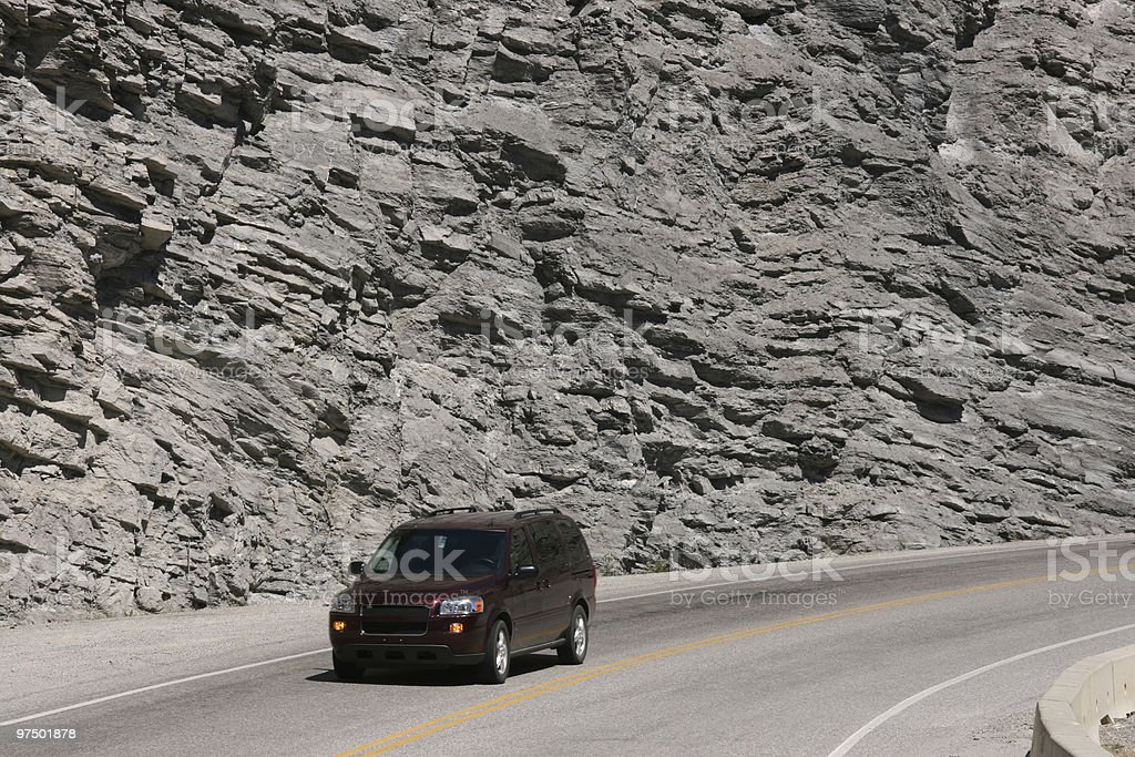 Mountain road and a car royalty-free stock photo