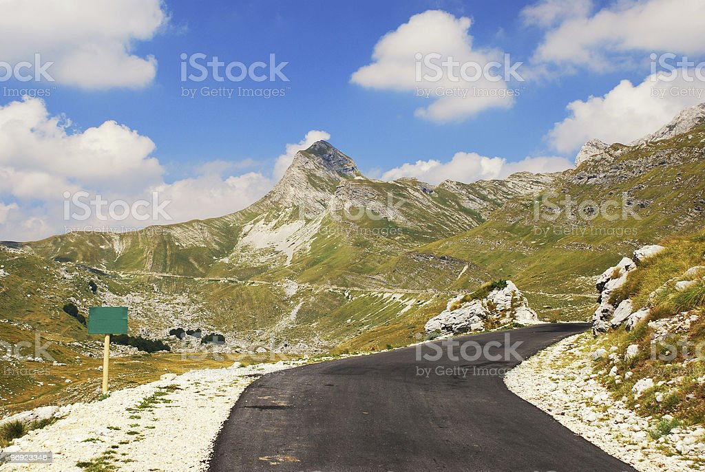 mountain road and high peak royalty-free stock photo