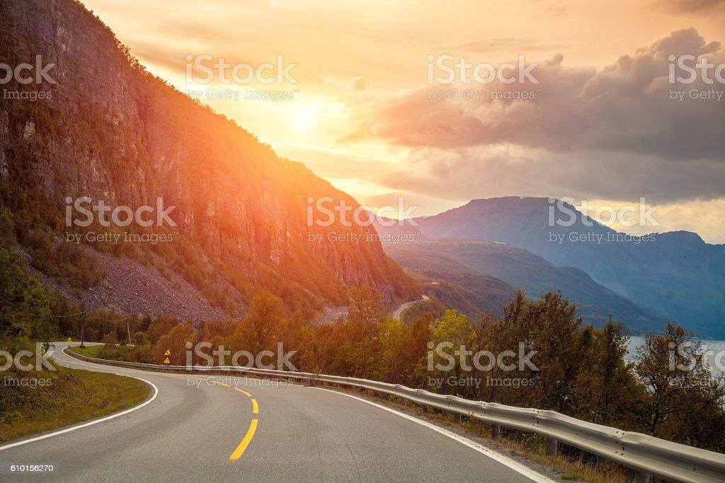Mountain road at sunset stock photo