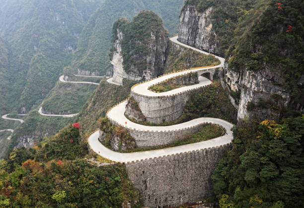 Mountain road, China Winding road in Tianmen Mountain National Park, Zhangjiajie, China steep stock pictures, royalty-free photos & images