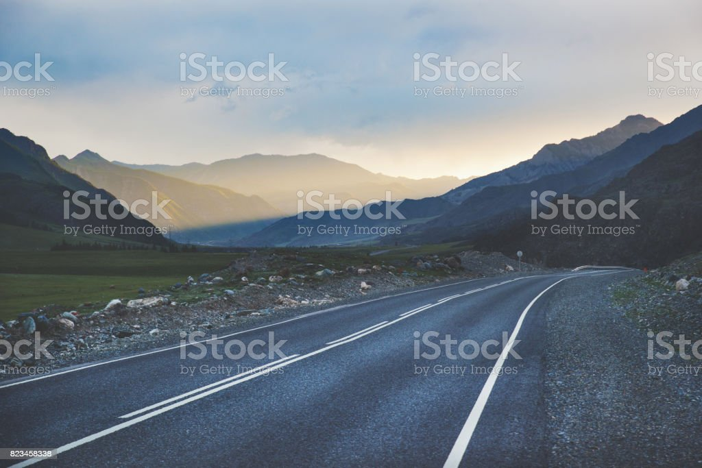 Mountain road on the sunset. stock photo