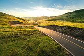 Curved backlit road,