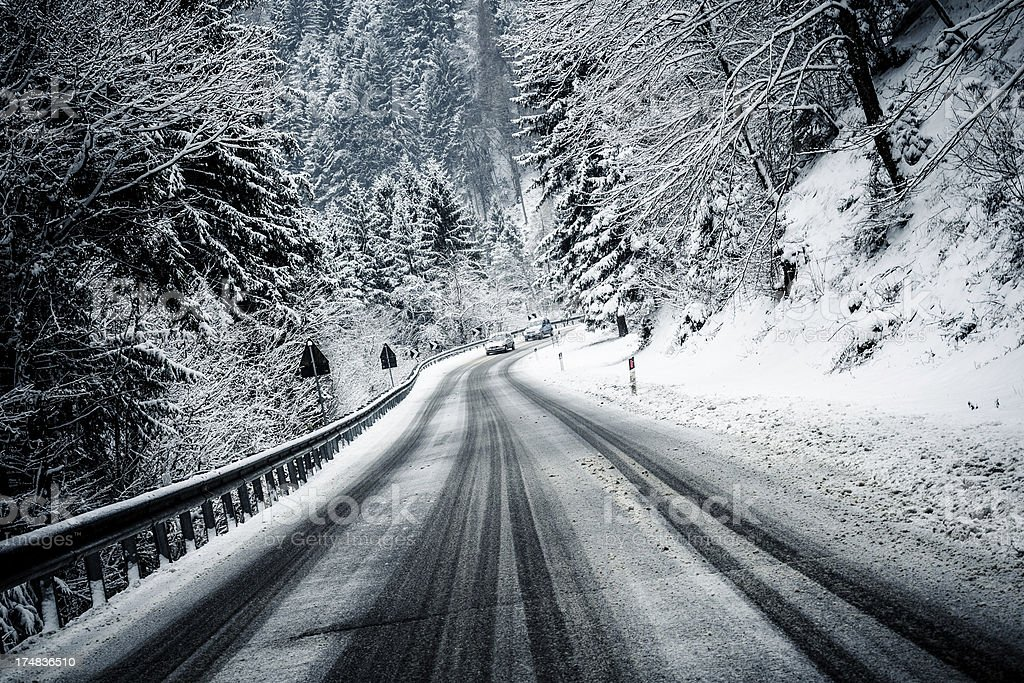 Mountain Road with Snow and Cars royalty-free stock photo
