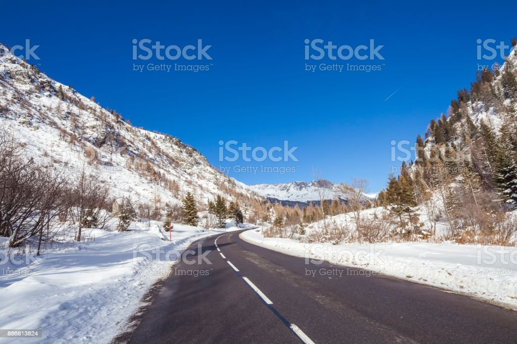 Mountain road without cars - French Alps near Chamonix - Winter stock photo