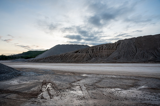 at the concrete factory there is a large mountain of sand