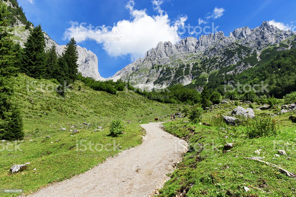 Mountain scene hiking in the Alps on a sunny day stock photo