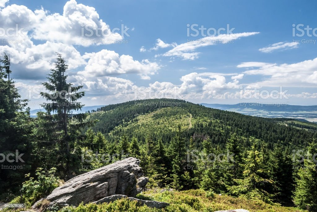 mountain scenery with hills, rock formation and blue sky stock photo