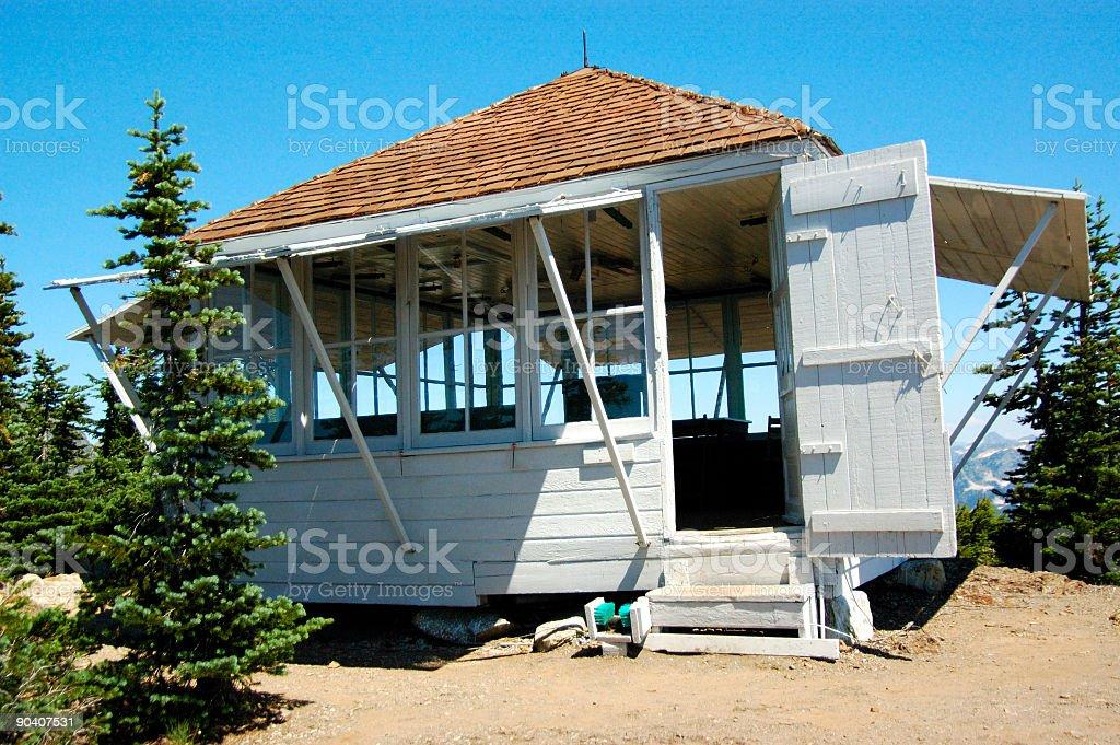 mountain shack on top of peak stock photo