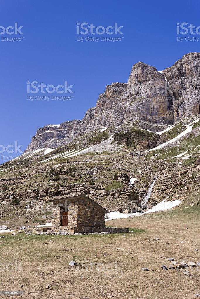 Mountain shelter with beautiful mountains in the background stock photo