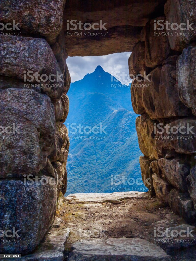 Mountain silhouette viewed through a window of Machu Picchu site, Peru stock photo