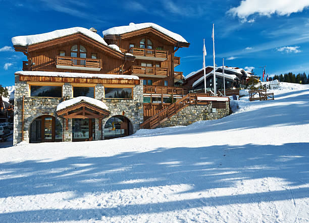 Mountain ski resort Mountain ski resort with snow in winter, Courchevel, Alps, France chalet stock pictures, royalty-free photos & images