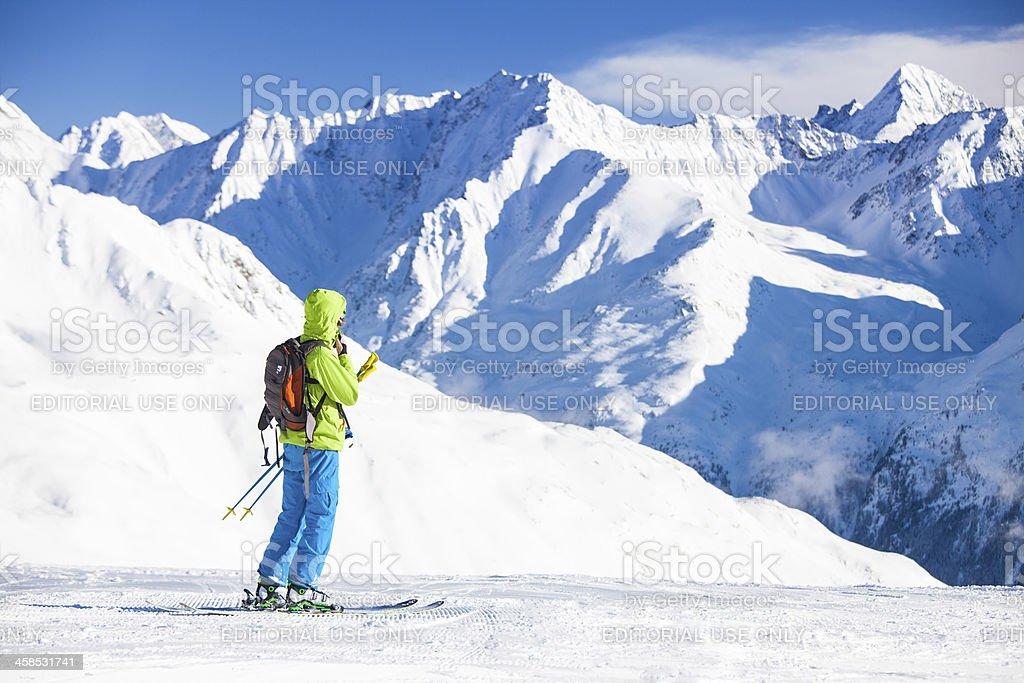Mountain skier in Austrian Alps royalty-free stock photo