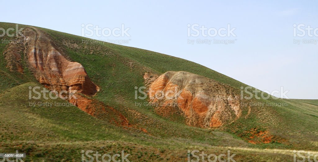 Mountain slopes with green grass panorama stock photo