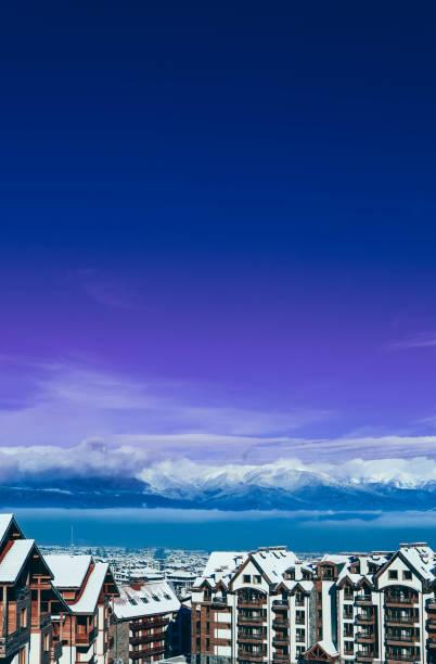 Mountain snow peak, Alpine village houses. stock photo