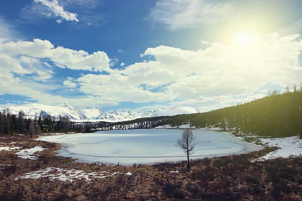 Mountain snowy lake. Russia, Siberia, Altay. Kidelu lake. stock photo