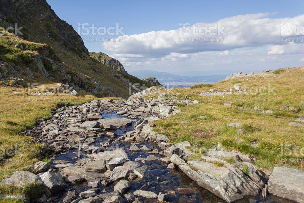 mountain spring near seventh Rila lakes in Bulgaria stock photo