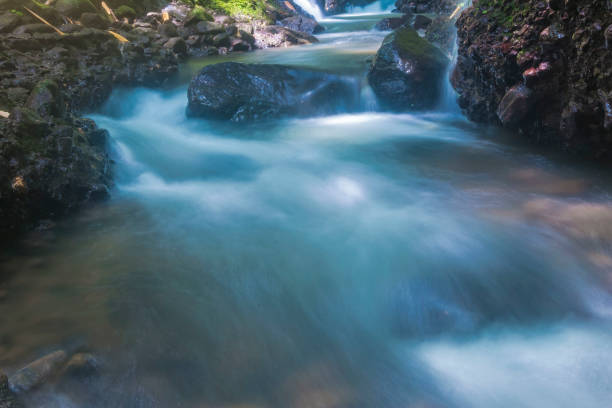 mountain springs with very heavy streams location at merapi mountain yogyakarta Indonesia stock photo