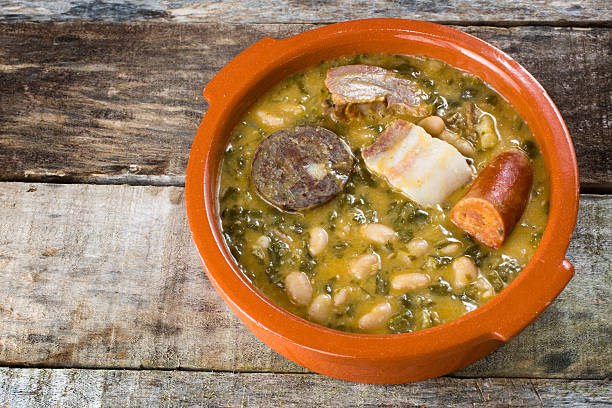 cocido montañés tasty spanish stew made with beans, cabbage and pork meat cantabria stock pictures, royalty-free photos & images